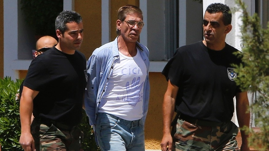April 22, 2016: EgyptAir plane hijack suspect Seif Eddin Mustafa, 59, 2nd right, with t-shirt is escorted by Cyprus police officers as he arrives in a court in capital Nicosia, Cyprus.