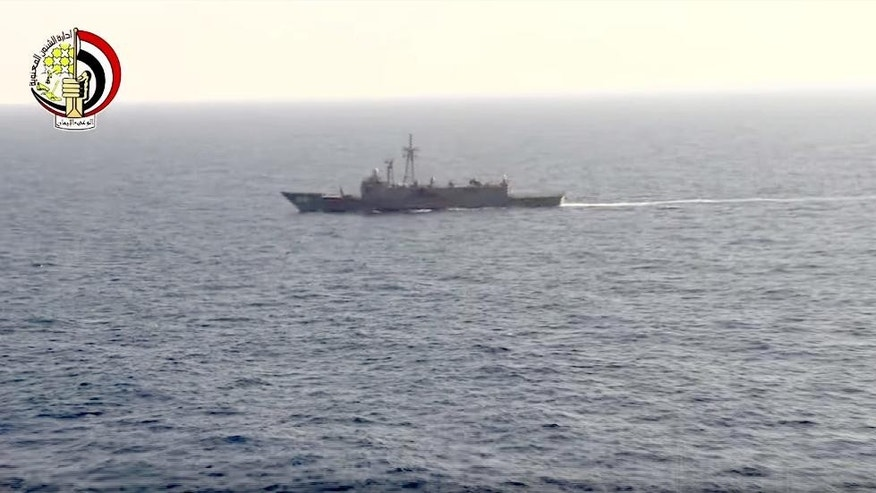 In this Thursday, May 19, 2016 video image released by the Egyptian Defense Ministry, an Egyptian ship searches in the Mediterranean Sea for the missing EgyptAir flight 804 plane which crashed after disappearing from radar early Thursday morning while carrying 66 passengers and crew from Paris to Cairo. The Egyptian army said Friday, May 20, 2016 that it has found wreckage of the missing Airbus 320 (290 kilometers) north of the city of Alexandria, Egypt. Logo in top left corner of the Egyptian Defense Ministry. (AP Photo/Egyptian Defense Ministry)