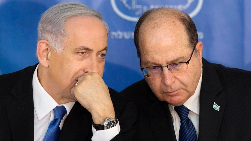 Feb. 16, 2015: Israeli Prime Minister Benjamin Netanyahu, left, speaks with Israel's Defense Minister Moshe Yaalon during a ceremony for new Israeli Chief of Staff Gadi Eizenkot at the Prime Minister's office in Jerusalem.
