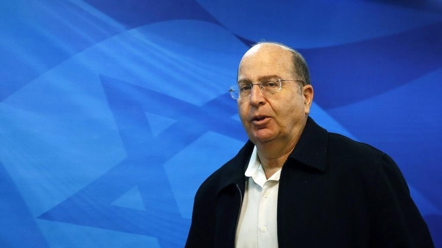 FILE -- In this Nov. 16, 2014 file photo, Israeli Defense Minister Moshe Yaalon arrives to the weekly cabinet meeting at the Prime Minister's Jerusalem office. Yaalon announced his resignation Friday, May 20, 2016, citing a lack of 'trust' in Prime Minister Benjamin Netanyahu. Reports over the past few days indicate that Netanyahu intends to appoint former foreign minister Avigdor Lieberman to the post. (AP Photo/Gali Tibbon, Pool, File)
