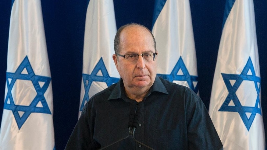"Israel's Defense Minister Moshe Yaalon, speaks during a press conference at the Defense Ministry in Tel Aviv, Israel,Friday, May 20, 2016. Israel's defense minister announced his resignation on Friday, citing a lack of ""trust"" in Prime Minister Benjamin Netanyahu after reports in recent days that he is soon to be replaced. (AP Photo/Sebastian Scheiner)"