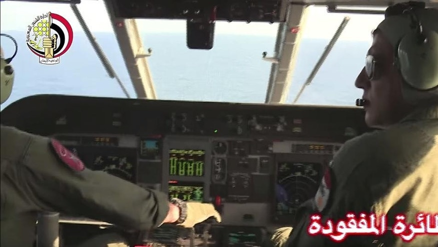 "In this Thursday, May 19, 2016 video image released by the Egyptian Defense Ministry, an Egyptian plane searches in the Mediterranean Sea for the missing EgyptAir flight 804 plane which crashed after disappearing from the radar early Thursday morning while carrying 66 passengers and crew from Paris to Cairo. The Egyptian army said Friday, May 20, 2016 that it has found wreckage of the missing Airbus 320 (290 kilometers) north of the city of Alexandria, Egypt. Logo in top left corner of the Egyptian Defense Ministry. Arabic at right reads, ""The missing plane."" (AP Photo/Egyptian Defense Ministry)"