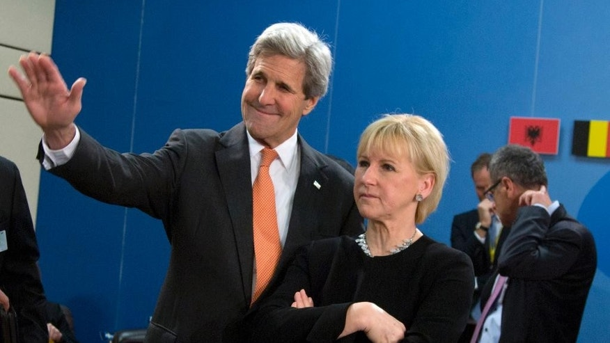 Swedish Foreign Minister Margot Wallstrom, right, speaks with U.S. Secretary of State John Kerry during a meeting of the North Atlantic Council at NATO headquarters in Brussels on Friday, May 20, 2016. NATO's chief says the alliance has reached a broad agreement to seek another meeting with Russia before NATO heads of state and government meet in Warsaw this July. (AP Photo/Virginia Mayo)