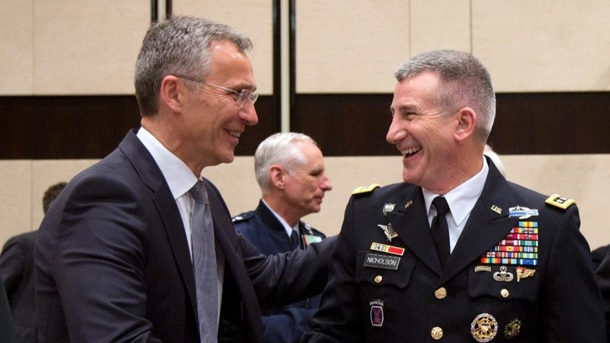 NATO Secretary General Jens Stoltenberg, left, shakes hands with Commander of Resolute Support Gen. John Nicholson during a meeting of the North Atlantic Council with Resolute Support Operational Partner Nations at NATO headquarters in Brussels on Friday, May 20, 2016. NATO has reached a broad agreement to seek another meeting with Russia before NATO leaders meet in Warsaw for a summit this July. (AP Photo/Virginia Mayo)