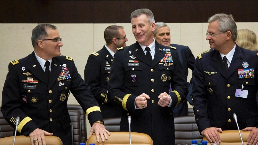 Commander of Resolute Support Gen. John Nicholson, center, speaks with Supreme Allied Commander Europe Gen. Curtis Scaparrotti,, left, and Supreme Allied Commander Transformation Gen. Denis Mercier, right, during a meeting of the North Atlantic Council with Resolute Support Operational Partner Nations at NATO headquarters in Brussels on Friday, May 20, 2016. NATO has reached a broad agreement to seek another meeting with Russia before NATO leaders meet in Warsaw for a summit this July. (AP Photo/Virginia Mayo)