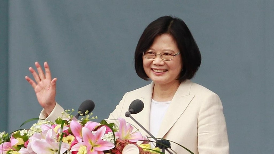 Taiwan's President Tsai Ing-wen waves to Taiwanese people as she delivers an acceptance speech during her inauguration ceremony in Taipei, Taiwan, Friday, May 20, 2016. Taiwan inaugurated Tsai Ing-wen as its first female president on Friday, returning the pro-independence Democratic Progressive Party to power amid new concerns over increasingly fractious relations with Beijing and a flagging economy. (AP Photo/Chiang Ying-ying)