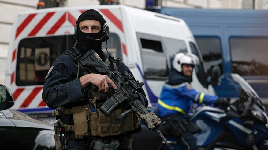 May 20, 2016: Members of French military task force GIGN secure the convoy transporting Paris attacks suspect, Salah Abdeslam as they leave the Paris courthouse.