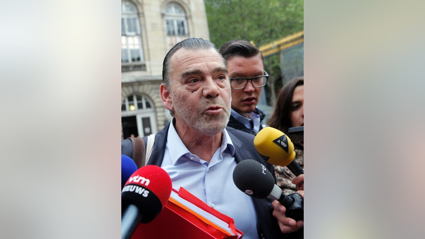 Frank Berton, lawyer of Paris attacks suspect Salah Abdeslam, addresses the media as he arrives at the Paris courthouse, Friday, May 20, 2016. The leading suspect in last November's Paris attacks is facing questioning Friday for the first time since his extradition from Belgium last month, and authorities hope Salah Abdeslam's testimony sheds light on Islamic State's strategies in Europe. (AP Photo/Christophe Ena)