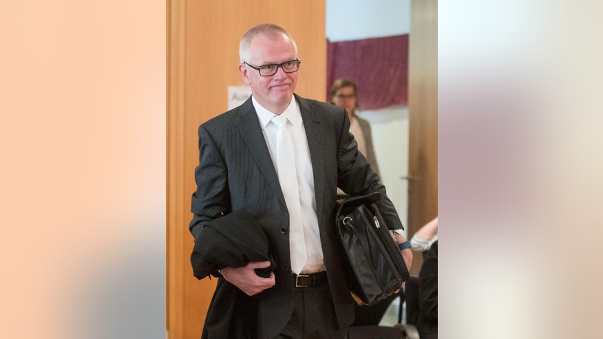 "Prosecutor Andreas Brendel  arrives at the court in Detmold , Germany Friday May 20, 2016. Prosecutors are seeking a six-year prison sentence for the former Auschwitz death camp guard  as an accessory to murder.  Prosecutor Andreas Brendel told the Detmold state court in closing arguments Friday that 94-year-old Reinhold  Hanning was guilty of being an accessory to murder in at least 100,000 cases,  news agency dpa reported. He said: ""The defendant played a part in the camp's purpose of annihilation.""  (Bernd Thissen/Pool Photo via AP) (Bernd Thissen/Pool Photo via AP)"