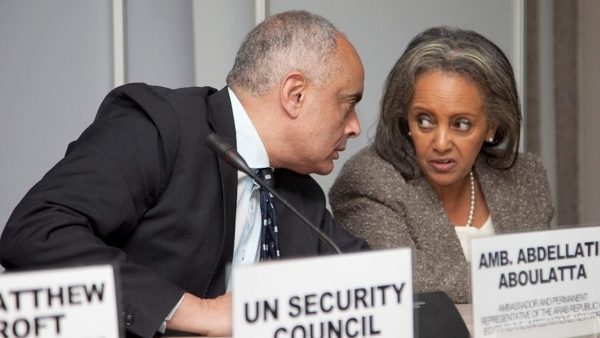 Amr Abdellatif Aboulatta, left, Egypt's ambassador to the U.N. and President of the United Nations Security Council and Sahle-Work Zewde, UN office Nairobi, consult each other during a press conference at UN Headquarters in Nairobi, Kenya. Friday, May, 20, 2016, after meeting with president of Republic of Kenya, Uhuru Kenyatta.  Members of the United Nations Security Council are visiting Kenya, which has been the scene of multiple attacks by al-Qaida-linked extremists allegedly based in neighboring Somalia. (AP Photo/Sayyid Abdul Azim)