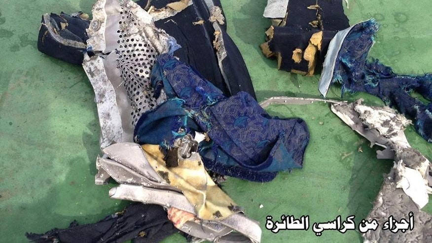 "This picture posted Saturday, May 21, 2016, on the official Facebook page of the Egyptian Armed Forces spokesman shows part of a plane chair from EgyptAir flight 804. Search crews found floating human remains, luggage and seats from the doomed EgyptAir jetliner Friday but face a potentially more complex task in locating bigger pieces of wreckage and the black boxes vital to determining why the plane plunged into the Mediterranean. Arabic reads: "" Part of plane chair"".  (Egyptian Armed Forces via AP)"