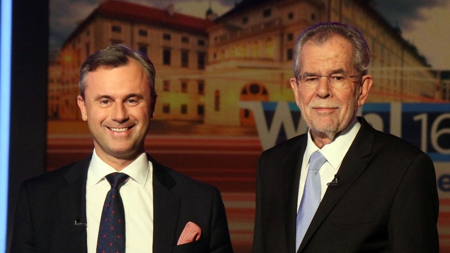 Norbert Hofer of Austria's Freedom Party, FPOE, and Alexander Van der Bellen, candidate of the Austrian Greens, from left, wait for the start of a TV debate in Vienna, Austria, Thursday, May 19, 2016. Europeans of all political stripes are focusing this weekend on Austrian elections that have significance far beyond the small EU nation's borders. (AP Photo/Ronald Zak)