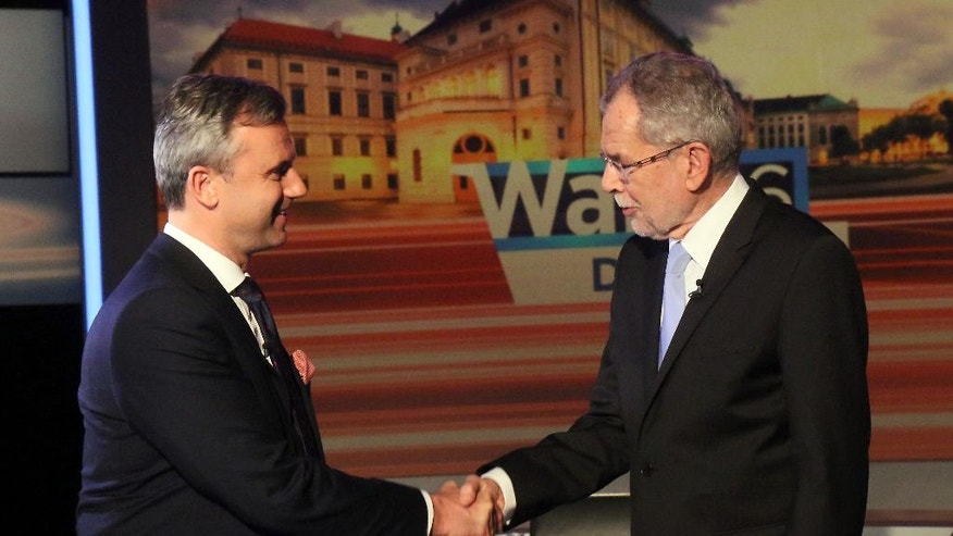 Norbert Hofer of Austria's Freedom Party, FPOE, shakes hands Alexander Van der Bellen, candidate of the Austrian Greens, from left, before the start of a TV debate in Vienna, Austria, Thursday, May 19, 2016. Europeans of all political stripes are focusing this weekend on Austrian elections that have significance far beyond the small EU nation's borders. (AP Photo/Ronald Zak)