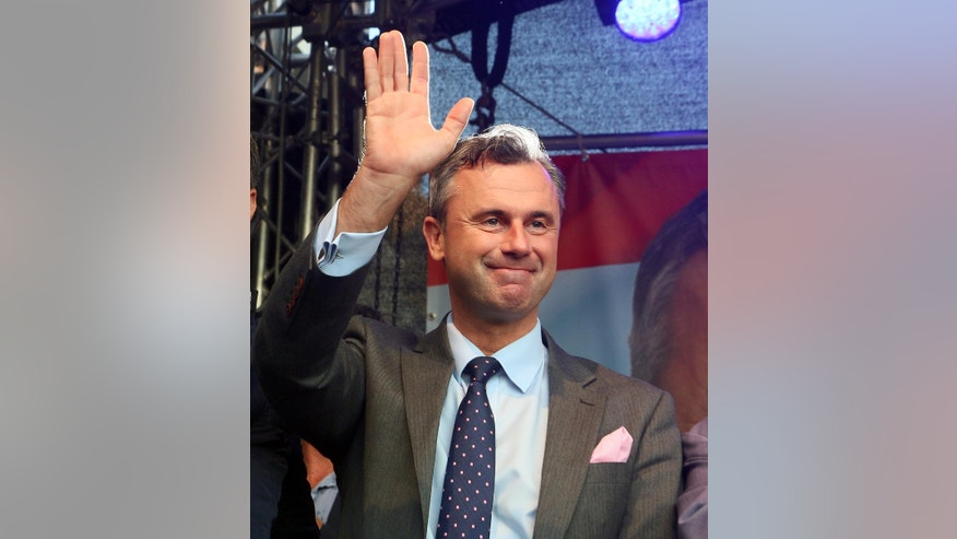 Norbert Hofer candidate for presidential elections of Austria's Freedom Party, FPOE, waves to supporters during the final election campaign event in Vienna, Austria, Friday, May 20, 2016.(AP Photo/Ronald Zak)