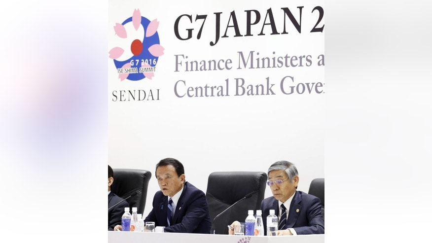 Japanese Finance Minister Taro Aso, left, speaks next to Bank of Japan Gov. Haruhiko Kuroda, right, during a press conference after a meeting of finance ministers and heads of central banks of the Group of Seven in in Akiu, northern Japan, Saturday, May 21, 2016. The G7 major economies showed a united front on fighting terrorist financing and tax evasion in talks that ended Saturday, but shied away from coordinated action on policies to revive stalling growth. Yohei Kanezashi/Kyodo News via AP) JAPAN OUT, MANDATORY CREDIT