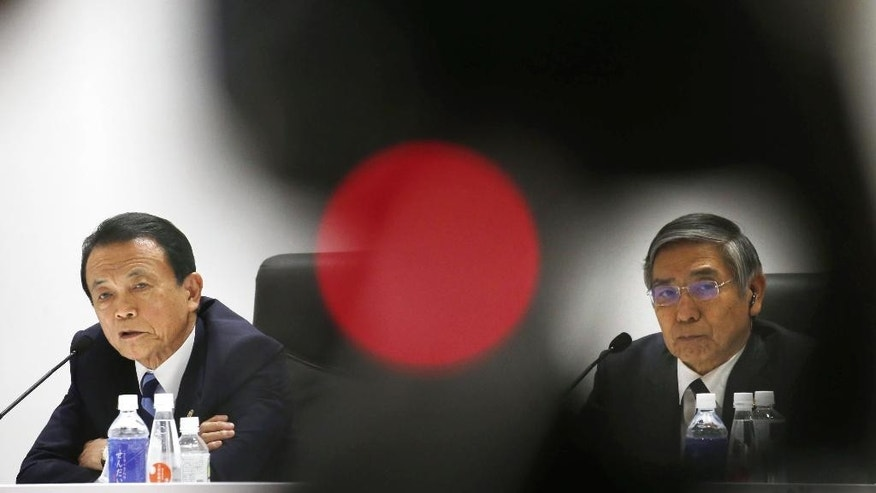Japanese Finance Minister Taro Aso, left, speaks next to Bank of Japan Gov. Haruhiko Kuroda, right, during a press conference after a meeting of finance ministers and heads of central banks of the Group of Seven in in Akiu, northern Japan, Saturday, May 21, 2016. The G7 major economies showed a united front on fighting terrorist financing and tax evasion in talks that ended Saturday, but shied away from coordinated action on policies to revive stalling growth. (Yohei Kanezashi/Kyodo News via AP) JAPAN OUT, MANDATORY CREDIT