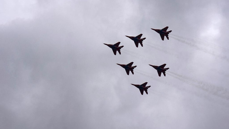 The Russian military's Strizhi (The Swifts) aerobatic team performs during an air show at the Kubinka air base outside Moscow, Russia, Saturday, May 21, 2016. The Russian military's elite aerobatic squadrons have marked their 25-year jubilee with an air show outside Moscow. (AP Photo/Vladimir Isachenkov)