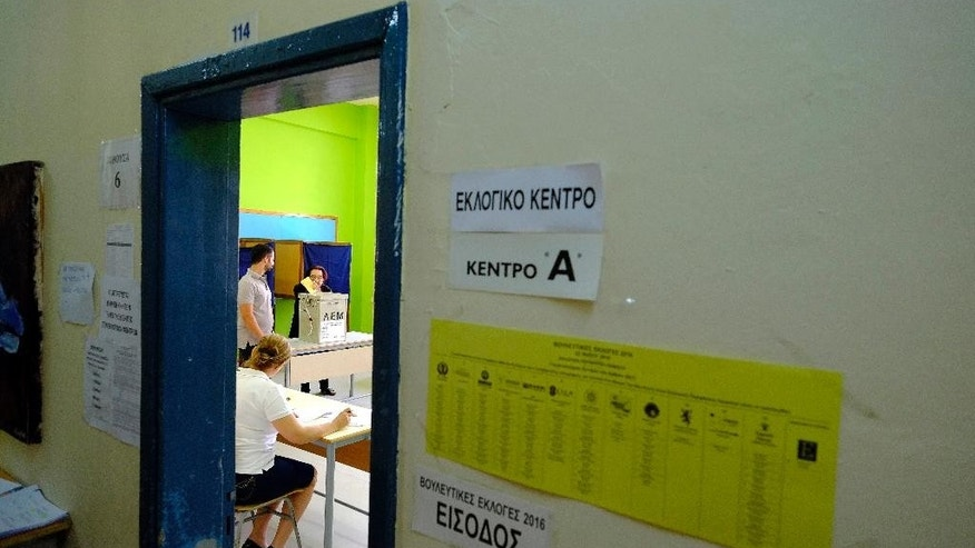 A woman casts her bllot at a polling station during the parliamentary elections in southern port city of Limassol in this mediterranean island of Cyprus, on Sunday, May 22, 2016. Cypriots elect a new parliament amid high voter disillusionment with what many see as the country's discredited political establishment. Some 543,000 voters are eligible to cast their ballots for 56 lawmakers. (AP Photo/Petros Karadjias)