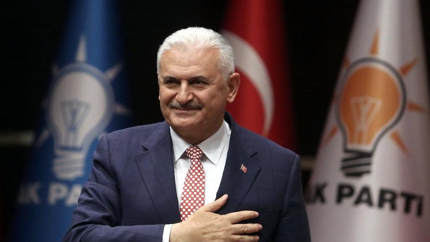Binali Yildirim, Turkey's current Transportation Minister and founding member of the AKP, Turkey's governing party, salutes during a meeting in Ankara, Turkey, Thursday, May 19, 2016. Officials of the Party tapped Yildirim as their candidate of choice as a new leader and the country's next prime minister. Yildirim will run unopposed for the party leadership at an extraordinary to be held Sunday in Ankara.(AP Photo)