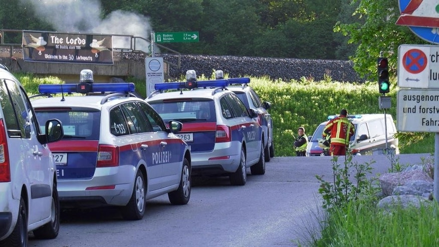 This image made from TV shows police attending the scene of a shooting near Nenzing, Austria, Sunday May 22, 2016. A gunman fired shots early Sunday into a small crowd attending an open air concert organized by a local motorcycle club, killing two people and wounding others before shooting himself to death, police said. (Laendle.TV via AP)  AUSTRIA OUT