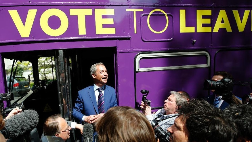 British politician and leader of the UKIP party Nigel Farage talks to members of the media as he launches his party's campaign for Britain to leave the EU, outside the EU representative office in London, Friday, May, 20, 2016. Britain will decide in one month whether to deal a historic hammer blow to the European integration project by placing their island nation on an independent path outside the European Union. (AP Photo/Alastair Grant )