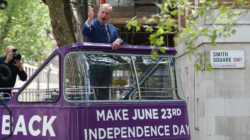 British politician and leader of the UKIP party Nigel Farage waves from the top of an open top bus as he arrives to launch his party's campaign for Britain to leave the EU in London, Friday, May, 20, 2016. Britain will decide in one month whether to deal a historic hammer blow to the European integration project by placing their island nation on an independent path outside the European Union. (AP Photo/Alastair Grant )