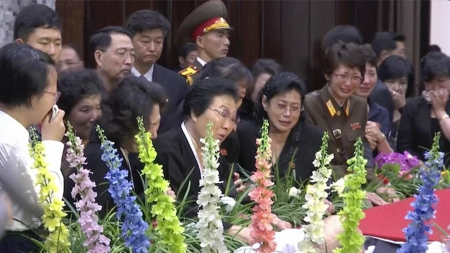 In this image made from video, family and officials mourn for North Korea's foreign policy specialist Kang Sok Ju, lying in state during funeral services at the Sojang Club, Sunday, May 22, in Pyongyang, North Korea. Kang died of cancer at the age of 76 on Friday, according to a news report released by the Korean Central News Agency early Saturday. (AP Photo/APTN)
