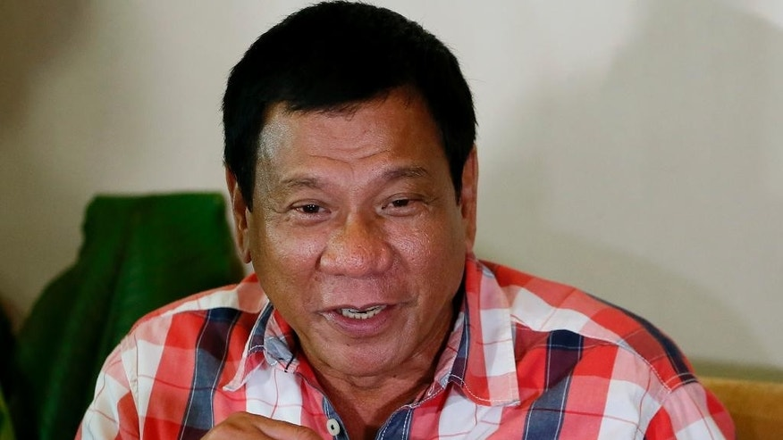 "FILE- in this May 9, 2016, file photo, then front-running presidential candidate Mayor Rodrigo Duterte gestures during his second news conference after voting in his hometown in Davao city in southern Philippines. The presumptive Philippine president-elect has blasted the country's dominant Roman Catholic church as ""the most hypocritical institution"" and accused some of its bishops of corruption for allegedly asking favors from politicians, including him. (AP Photo/Bullit Marquez, File)"
