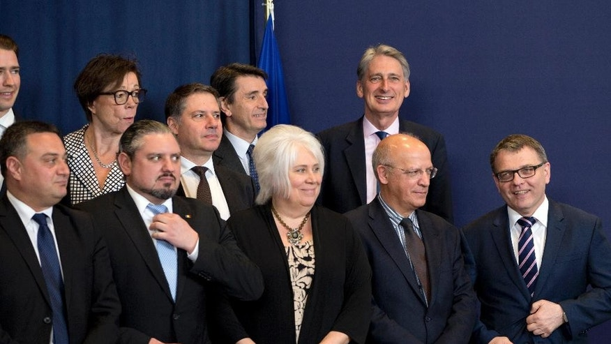 British Foreign Minister Philip Hammond, rear left, stands with other EU foreign ministers prior to a group photo at the EU Council building in Brussels on Monday, May 23, 2016. Libya has given the European Union a green light to begin training its coast guard, as increasing numbers of migrants leave the country bound for Italy. (AP Photo/Virginia Mayo)