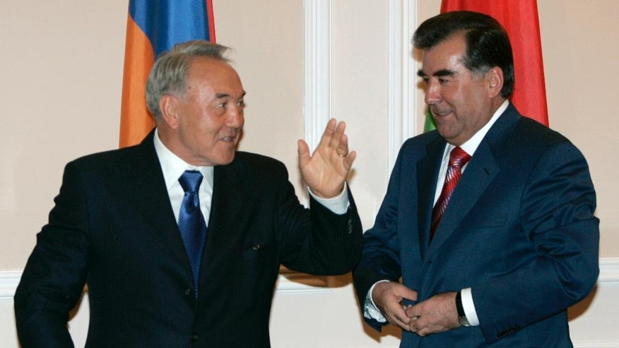 FILE - In this Friday Oct. 5, 2007 file photo, Kazakhstan's President Nursultan Nazarbayev, left, and Tajikistan's President Emomali Rakhmon talk after a news conference during a Summit of the Commonwealth of Independent States in the Tajik capital of Dushanbe. Rakhmon's title looks almost certainly to have been copied from Kazakhstan, where President Nursultan Nazarbayev was elevated to Leader of the Nation in 2010. (AP Photo/Sergei Grits, file)