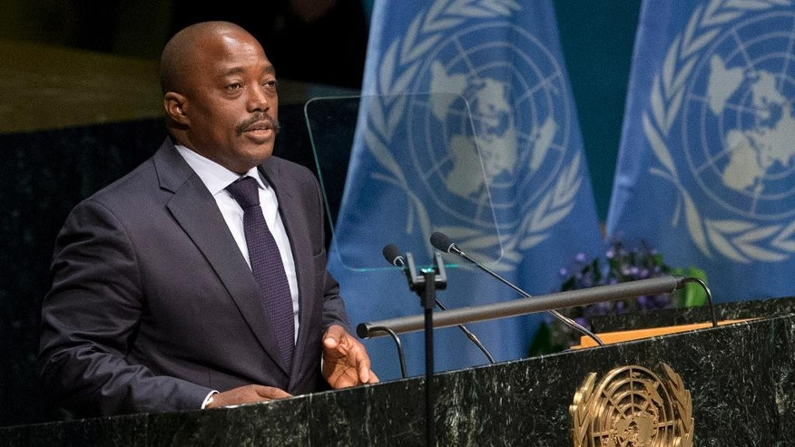 FILE - In this file photo dated Friday, April 22, 2016, Congolese President Joseph Kabila speaks Friday, April 22, 2016 at U.N. headquarters.  Longtime incumbent Kabila is constitutionally barred from seeking another term in office, but Congo's top opposition candidate for the upcoming presidential election Moise Katumbi flew to South Africa for medical treatment Friday May, 20, 2016, one day after authorities issued an arrest warrant for him. (AP Photo/Mary Altaffer, FILE)