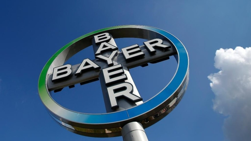 FILE - The Oct. 2, 2013 file photo shows the logo of Bayer at the Berlin Brandenburg Airport in Schoenefeld, Germany. German drug and chemicals company Bayer AG says it has made a $62 billion offer to buy U.S.-based crops and seeds specialist Monsanto Company. Bayer said Monday, May 23, 2016 that the all-cash offer values Monsanto shares at $122 each. (AP Photo/Michael Sohn, File)