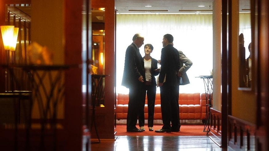 Frauke Petry,  second  from left, chairwoman of the right-wing populist party AfD, Alternative for Germany, discusses with other members of the party in a corridor of a hotel after a meeting with members of the Central Committee of Muslims in Germany, in Berlin, Germany, Monday, May 23, 2016. (AP Photo/Markus Schreiber)