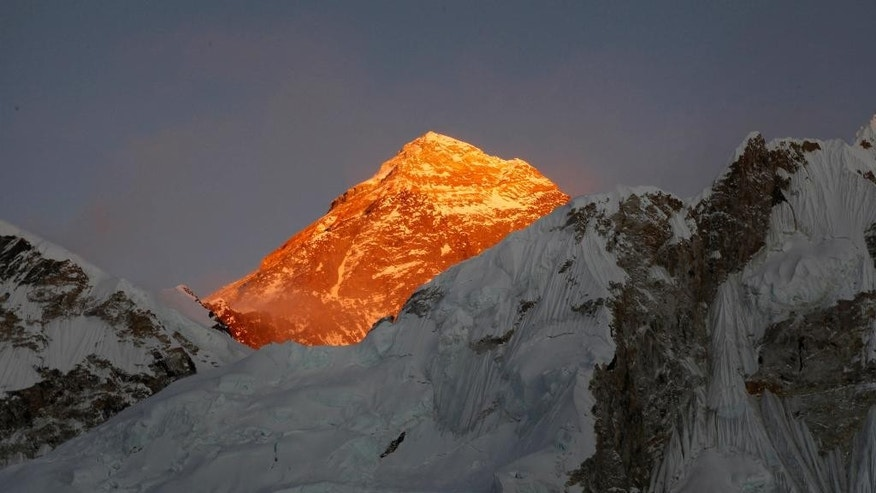 FILE - In this Nov. 12, 2015, file photo, Mt. Everest is seen from the way to Kalapatthar in Nepal. An Indian climber has died while being helped down Mount Everest, just a couple of days after a Dutch and an Australian died near the peak. Two other Indian climbers are missing, and experts say some of the tragedy may have been avoidable. (AP Photo/Tashi Sherpa, File)