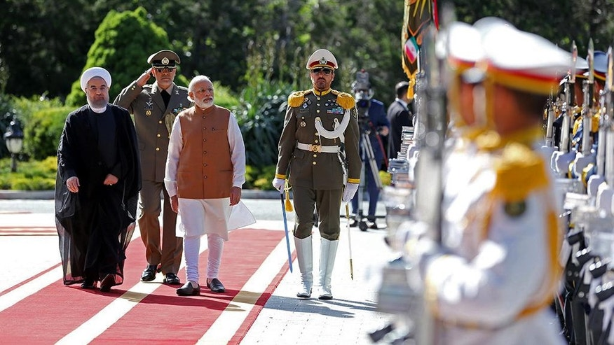 Indian Prime Minister Narendra Modi, third left, and Iranian President Hassan Rouhani, left, review the honor guard during a welcoming ceremony at the Saadabad Palace in Tehran, Iran, Monday, May 23, 2016. (Iranian Presidency Office via AP)