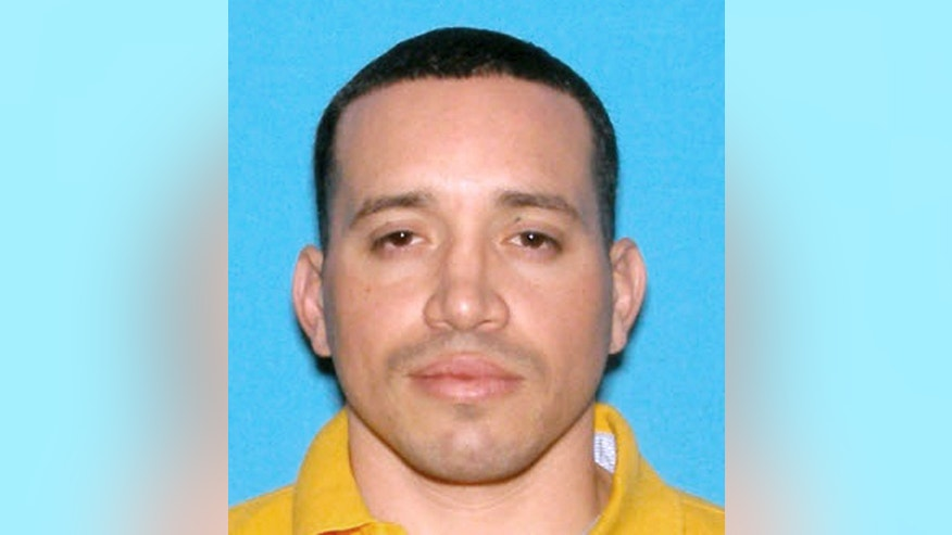 This undated identification photo released by the Massachusetts State Police shows Jorge Zambrano, killed Sunday, May 22, 2016, during an exchange of gunfire with police at an apartment building in Oxford, Mass. Zambrano had been suspected in the shooting death of Auburn, Mass., Police Officer Ronald Tarentino during a traffic stop early Sunday morning. (Massachusetts State Police via AP)