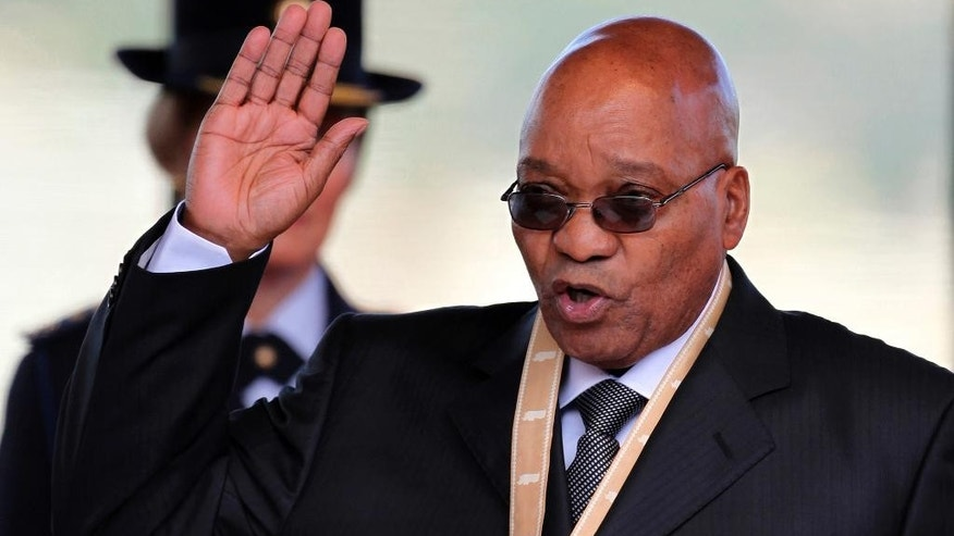 FILE - In this Saturday May 9, 2009 file photo South Africa's president Jacob Zuma takes an oath during his inauguration in Pretoria, South Africa, for a first term. On Monday, May 24, 2016 state prosecutors said they will appeal a court ruling that could have opened the way to corruption charges against Zuma, in 2009 relating to a multi-billion dollars arms deal in 1999. (AP Photo/Themba Hadebe, File)