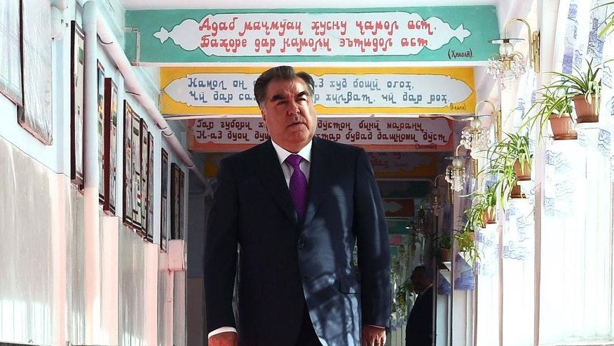 Tajik President Emomali Rakhmon arrives at a polling station in Dushanbe, Tajikistan, Sunday, May 22, 2016. Tajikistan holds a referendum on changing the constitution to allow Rakhmon to remain in office for life and to make it easier for his eldest son to succeed him as leader of the former Soviet republic in Central Asia. (Tajikistan Presidential Press Service via AP)