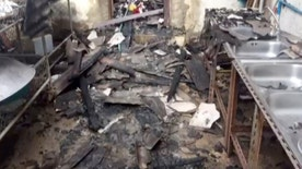 In this image made from video, the inside of a damaged school dormatory is seen where local police say 18 girls, ranging from 5 to 12 years old, died in a fire in Chiang Rai province, northern Thailand, May 23, 2016. Police officials say five other girls were injured, with two in serious condition, in the fire, late Sunday. ( Voice TV Thailand via AP) THAILAND OUT