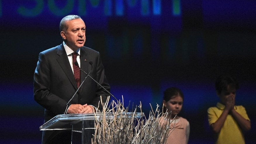 Turkey's President Recep Tayyip Erdogan, delivers a speech at the opening ceremony of the World Humanitarian Summit, in Istanbul, Monday, May 23, 2016. World leaders and representatives of humanitarian organisations from across the globe converge in Istanbul on May 23-24, 2016 for the first World Humanitarian Summit, focused on how to reform a system many judge broken. (AP Photo/Lefteris Pitarakis)