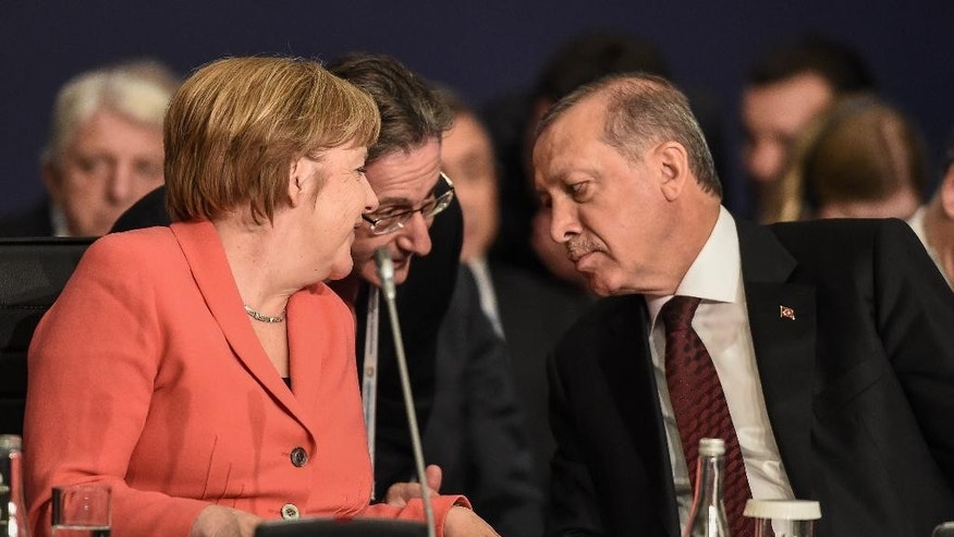 "German Chancellor Angela Merkel, left, talks through an interpreter to Turkey's President Recep Tayyip Erdogan, right, during a roundtable meeting on ""Political Leadership to Prevent and End Conflicts"" at the World Humanitarian Summit in Istanbul, Monday, May 23, 2016. World leaders and representatives of humanitarian organisations from across the globe converge in Istanbul on May 23-24, 2016 for the first World Humanitarian Summit, focused on how to reform a system many judge broken. (Ozan Kose/Pool Photo via AP)"