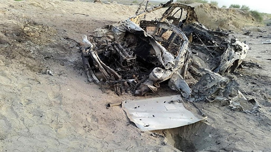 May 22, 2016: This photo purports to show the destroyed vehicle in which Mullah Mohammad Akhtar Mansour was traveling in the Ahmad Wal area in Baluchistan province of Pakistan, near Afghanistan's border.