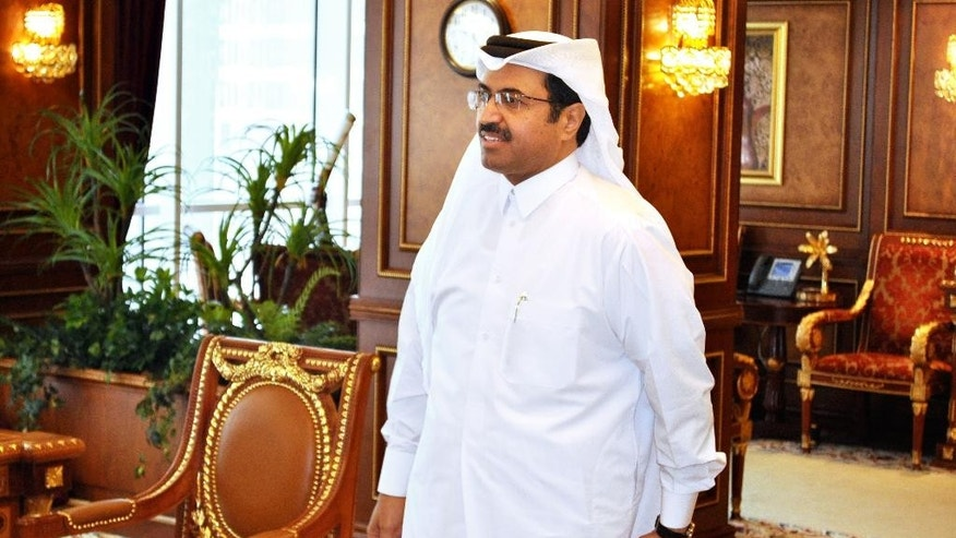 """Mohammed bin Saleh al-Sada, Qatar's minister of energy and industry, arrives at his office in Doha, Qatar, Tuesday, May 24, 2016. The oil market is slowly recovering from its steep drop over the past two years but crude is still not trading at a """"fair price"""" to encourage necessary investment, Qatar's energy and industry minister said Tuesday, ahead of next week's meeting of OPEC producers. (AP Photo/Adam Schreck)"""