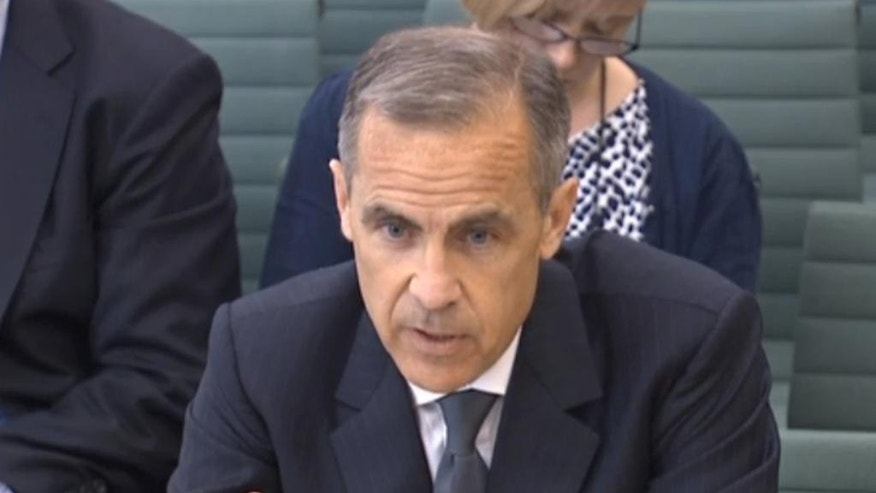 In this image taken from video Governor of the Bank of England Mark Carney gives evidence to Britain's parliamentary  Commons Treasury Committee on the Bank of England inflation report in London Tuesday May 24, 2016. (PA via AP) UNITED KINGDOM OUT