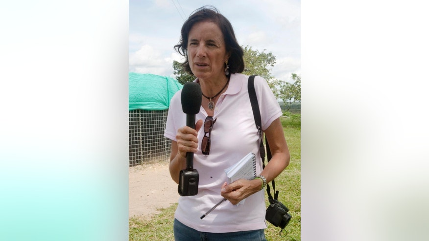 This undated photo, courtesy of El Tiempo newspaper, shows Salud Hernandez-Mora, correspondent in Colombia for Spain's El Mundo and columnist for the Bogota daily El Tiempo, working in an unknown location in Colombia. Security forces are searching for Hernandez-Mora, who was last seen on Saturday, May 21, 2016 in El Tarra, on the northeastern Colombia's border with Venezuela, a mountainous area dominated by leftist rebels and drug-traffickers. (El Tiempo via AP)