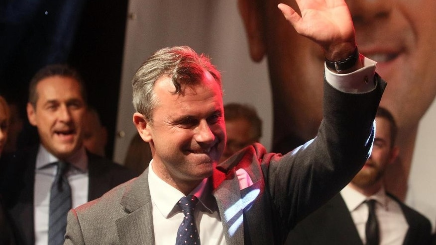 FILE - In this May 22, 2016 file picture Norbert Hofer presidential  candidate for Austria's  Freedom Party, FPOE, waves during an  election party in Vienna, Austria. The right-wing candidate in Austria's presidential election has acknowledged defeat to a left-leaning rival, in a Facebook post thanking his backers for their support Monday May 23, 2016. .  (AP Photo/Ronald Zak, filr)