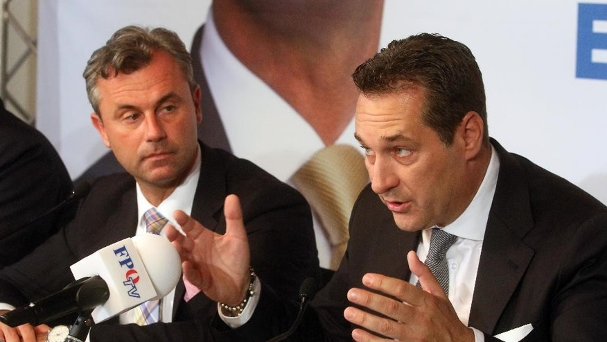 Norbert Hofer candidate for Austria's Presidency and Heinz-Christian Strache, head of Austria's Freedom Party, FPOE, from left, inform  the press in Vienna, Austria, Tuesday, May 24, 2016. (AP Photo/Ronald Zak)