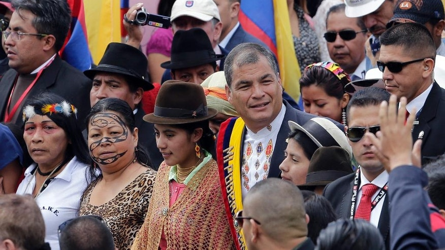 Ecuador's President Rafael Correa arrives to the National Assembly to give his last annual state-of-the-nation address in Quito, Ecuador, Tuesday, May 24, 2016. (AP Photo/Dolores Ochoa)