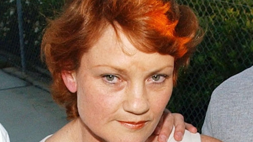 FILE - In this Nov. 6, 2003, file photo, former right-wing political leader Pauline Hanson, speaks to the media after her release from prison. Right-wing politician Pauline Hanson, who opposes Muslim immigration, has a realistic chance of returning to Australia's Parliament in July elections, political scientists said Tuesday, May 24, 2016. Hanson was sentenced to three years in prison in 2003 on a conviction of illegally registering her party in 1997 and of fraudulently claiming electoral funding. She was released after 11 weeks when an appeal court overturned the conviction. (AP Photo/Rick Rycroft, File)
