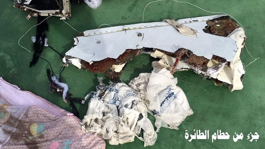 "FILE - This picture posted Saturday, May 21, 2016, on the official Facebook page of the Egyptian Armed Forces spokesman shows part of the wreckage from EgyptAir flight 804. Human remains retrieved from the crash site of EgyptAir Flight 804 suggest there was an explosion on board that may have brought down the aircraft in the east Mediterranean, a senior Egyptian forensics official said on Tuesday, May 24, 2016. Arabic reads, ""Part of plane wreckage."" (Egyptian Armed Forces Facebook via AP, File)"